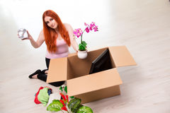 The young woman moving house in lifestyle concept Royalty Free Stock Images