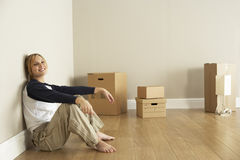 Young Woman Moving Into New Home Royalty Free Stock Images