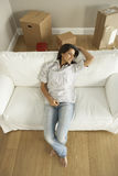Young Woman Moving Into New Home Stock Images