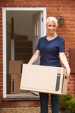 Young Woman Moving Into New Home Stock Photo