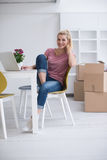 Young woman moving in a new home Stock Photography