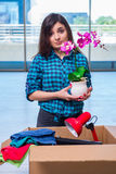 The young woman moving personal belongings Stock Images
