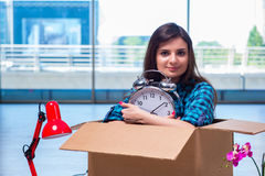 The young woman moving personal belongings Stock Image