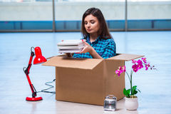 The young woman moving personal belongings Royalty Free Stock Image