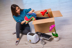 The young woman moving personal belongings Stock Photography