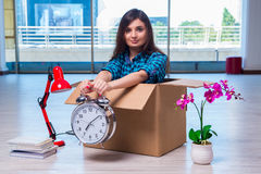 The young woman moving personal belongings Stock Photo