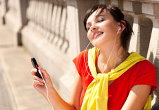 Young woman with mp3 player, smiling Stock Images