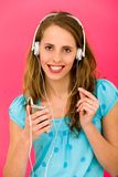 Young woman with MP3 player Royalty Free Stock Images