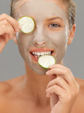 Young woman with mud mask cucumber slices. Beautiful woman with mud mask cucumber slices Stock Photos