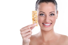 Young woman with muesli bar Stock Photo