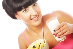 Young woman with muesli and milk Royalty Free Stock Images