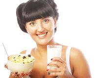 Young woman with muesli and milk Stock Image