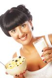 Young woman with muesli and milk Stock Photos
