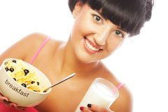 Young woman with muesli and milk Royalty Free Stock Photography