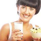 Young woman with muesli and milk Royalty Free Stock Photo