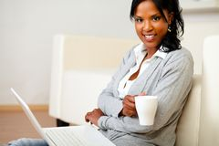 Young woman with a mug looking to you Royalty Free Stock Photo