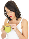 Young Woman with a Mug of Tea and Biscuit Stock Image