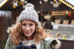Young woman with a mulled wine Stock Image