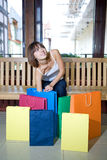 Young woman with multi-coloured bags Royalty Free Stock Images