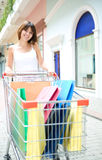 Young woman with multi-coloured bags Royalty Free Stock Photography