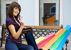 Young woman with multi-coloured bags Stock Photos