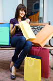 Young woman with multi-coloured bags Stock Photo