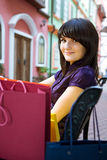Young woman with multi-coloured bags Royalty Free Stock Photo