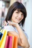Young woman with multi-coloured bags Royalty Free Stock Photos