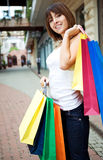 Young woman with multi-coloured bags Stock Image