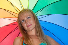 Young woman with multi-coloured umbrella. Royalty Free Stock Photo