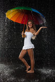 Young woman with multi-coloured umbrella. Stock Photos