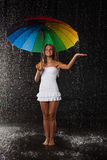 Young woman with multi-coloured umbrella. Stock Image