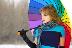 Young woman with multicolor umbrella Royalty Free Stock Photos