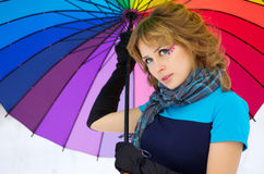 Young woman with multicolor umbrella Royalty Free Stock Images