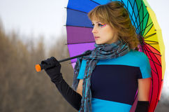 Young woman with multicolor umbrella Stock Photo