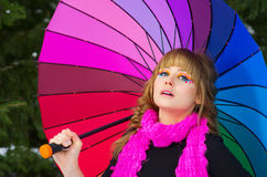 Young woman with multicolor umbrella Royalty Free Stock Photography
