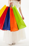 Young woman with multicolored shopping bags Stock Photography