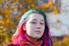 Young woman with multicoloured streaks hair stock photography