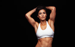 Young woman with muscular build Royalty Free Stock Image