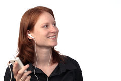 Young Woman with Music Player royalty free stock photo