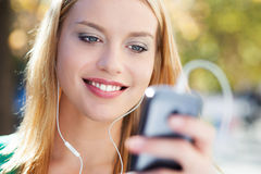 Young woman with music player Royalty Free Stock Photos