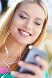 Young woman with music player Stock Image