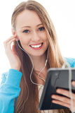 Young woman with music player Stock Photography
