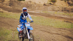 Young woman mx biker - motocross racer on dirt bike at sport track Stock Photography