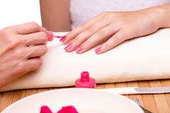The young woman in nail treatment medical concept Stock Images