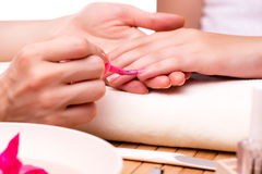 The young woman in nail treatment medical concept Royalty Free Stock Photos