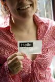 Young woman with name tag Royalty Free Stock Photography