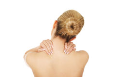 Young woman with nape pain. Royalty Free Stock Images