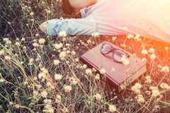 Free Young Woman Napping On The Dandelion Field After Reading Book Pu Royalty Free Stock Image - 79481406