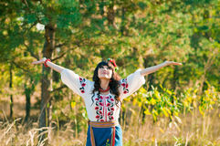 Young woman in national ukrainian clothes on the Royalty Free Stock Photos